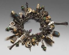 Susan Lenart Kazmer - the Queen of Found Object Jewelry. She is also a very thoughtful jeweler. Check out her website.