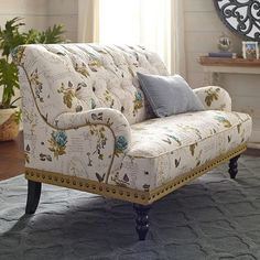 Our favorite chaise has gotten a floral makeover. The plush, tufted design features beautiful botanicals, accented with a soft script on a warm neutral background. Add a complementary lamp and you have the perfect place to enjoy a hot cup of coffee. Victorian Sofa, Victorian Furniture, Furniture Decor, Living Room Furniture, White Furniture, Chair And A Half, Home Wallpaper, Settee, Chair Design
