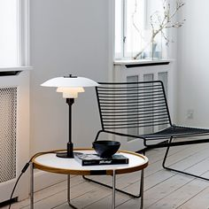 The PH 3½ - 2½ Table Lamp is a design based on Paul Henningsen's three shade system. http://www.ylighting.com/louis-poulsen-ph3-5-2-5-table-lamp.html