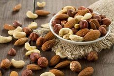 Assorted Nuts Almonds Hazelnuts Cashews Peanuts Stock Photo (Edit Now) 208604938 Tips To Gain Weight, Weight Gain Diet, Fruit Sec Regime, Omega 3, Pinole Cookies, Foods To Lower Triglycerides, Healthy Food List, Healthy Recipes, Assorted Nuts