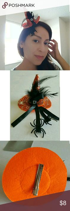 "Orange Witch Hat Fascinator Halloween Costume Show your Halloween Spirit with this Sexy Mini Witch Hat Fascinator Hair Accessory. Orange felt with silver spider web print. Black feathers, net & satin ribbon accents. Rhinestone buckle. 2 spiders crawling up the ribbon. New. 12+ years. 4"" tall x 4.5"" wide. Hair clip attached. Accessories Hair Accessories"