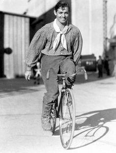 "Clark Gable bikes between scenes of ""Love on the Run"""