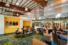 Collaborative Learning: Scotts Valley Library occupies a former indoor roller rink. The roller rink inspired the raised platform that forms ...