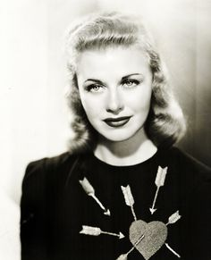 Ginger Rogers photographed by John Miehle, 1938.     LOVE THE SWEATER WITH ARROWS !!