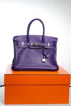 Would you carry a purple bag?  This one is by Hermes. It's a Birkin Bag
