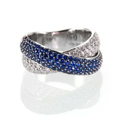 A stunning piece with this double cross over ring with pave set Blue Sapphires and Diamonds in an 18ct White Gold ring. Description from holtsgems.com. I searched for this on bing.com/images