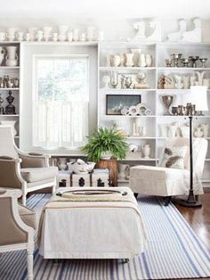 If you tend to amass large numbers of small collectibles, consider climbing the walls, as tabletops offer limited space to showcase favourite finds. Bookshelves keep things interesting, grouping clusters of similar items in various sections. Gather fluted vases and trophy-like urns, but stagger heights and mix various creamy shades. Occasional inconsistencies, like shells or architectural remnants and tarnished silver, highlights the monochromatic effect and keep it from seeming mundane.