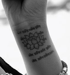 Lotus And Sanskrit Spiritual Tattoo On Wrist