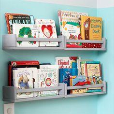 Use spice racks as inexpensive forward-facing bookshelves.