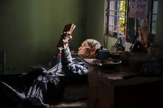 stevemccurrystudios:  Elderly man in Mandalay, Burma, reads by the window.  This amazing portrait by Steve McCurry is now our new cover phot...
