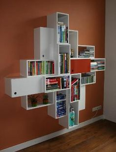 Symmetric designed bookcase with 16 squares by BuitenOosten