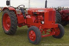 A 1956 Nuffield Universal 3 that has been modified with two seats and an offset steering system. More Tractor Photos. Vintage Tractors, Old Tractors, Tractor Photos, Classic Tractor, Royalty Free Photos, British, Yard, Unique, Tractors