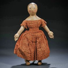Wonderful antique doll!  Love the dress fabric and her big hands!