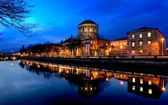 Ireland -- The Four Courts in Dublin, at night, next to the River Liffey.