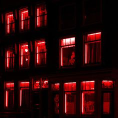 Holland | via Tumblr - red lights illuminate windows at night