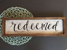 Hand Lettered Redeemed Rustic Wood Sign Specs: - Sign is approximately 24 x 6 - Hardware is included and comes attached to the frame - The base of the sign is a dark brown stain and is then painted and distressed - The sign is coated with a clear sealant to keep it protected for the years to come! If you would like to choose the custom option, please message me prior to purchasing so that we can speak about what it is that you would like. After we have discussed it, you then proceed to…