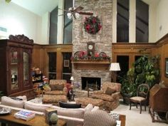 two story open great room with a coffered ceiling. stone fireplace