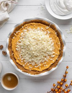 This pumpkin mousse pie is no bake! It has a macadamia crust and white chocolate and is delicious served cold out of the fridge or freezer! howsweeteats.com
