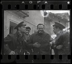 Robert Capa, [Ernest Hemingway (third from the left), New York Times journalist Herbert Matthews (second from the left) and two Republican soldiers, Teruel, Spain], late December 1937. © Estate of Cornell Capa / ICP/ Magnum. International Center of Photography
