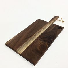 """The """"Paddle Cutting and Cheese Board"""" is modern design, made in the USA of Walnut, Cherry, Maple or Oak, cut in the shape of a golden rectangle, perfect aesthetic proportion, with square softly rounde"""