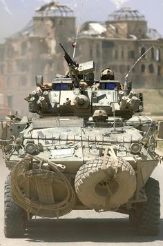 A Coyote armored reconnaissance vehicle with the Kabul Multinational Brigade armored reconnaissance squadron drives past the ruins of the Kings Palace en route to a checkpoint outside of Kabul Afghanistan : MilitaryPorn Army Vehicles, Armored Vehicles, Armored Car, Military Photos, Military History, Us Marines, Lav 25, Tank Armor, Canadian Army
