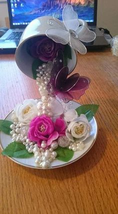 floating tea cup https://www.facebook.com/Simones-crafts-Bookfolding-Book-art-179091748860259/