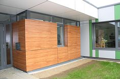 fundermax Exterior Wall Cladding, Building Front, Entrance Design, Front Entrances, Architecture, Garage Doors, Shed, Outdoor Structures, Facades