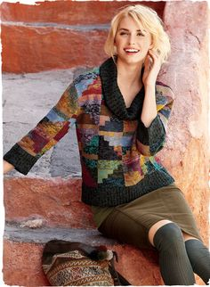 A wearable work of art, Kaffe Fassett's pre-Columbian inspired pima (75%) and alpaca (25%) sweater is handknit in a palette of richly tweeded hues. The cropped, boxy silhouette is framed in a plaited rib at the cowlneck, sleeves and hem.