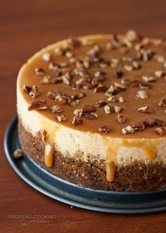 """A cross between cheesecake and pumpkin pie, this cheesecake is even more moist and delicious when """"baked"""" in the pressure cooker. Serve it topped with creamy caramel and crunchy pecans."""