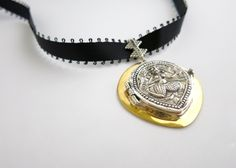 """Amuletic choker with ancient """"goddess/devi"""" die-stamp embossing in sterling silver with gold plated brass detailing."""