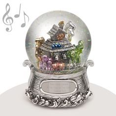 "Musical Water Globe - Noah's Ark - The perfect gift for any little angel; this water globe features Noah's Ark animals. Two-by-two! The base of the snowglobe is the ark riding through the waves. An ideal keepsake for a new baby or baptism. The music that plays is ""Talk to the Animals."""