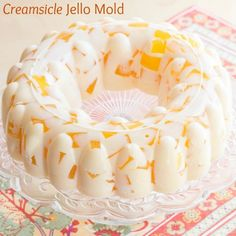 Creamsicle Jello Mold is totally retro with cubes of fresh orange juice gelatin seemingly floating in a sea of wobbly vanilla ice cream.