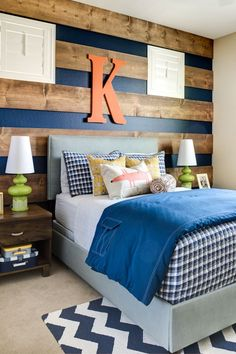 I love the wood on the walls! I think this might be an idea for the new house!!! Looks like a boys bedroom idea