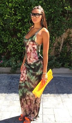 Shaniece Hairston smoldered in a Young Broke & Fabulous tie-dye sleeveless maxi dress