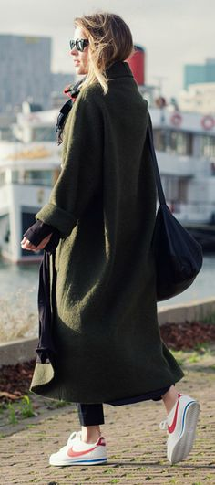 Wear the maxi coat trend like Christine R with a pair of cute sneakers, cigarette trousers, and a tartan scarf to accessorise. Maxi Coat: Designed by Christine, Trousers/Bag: COS, Sneakers: Nike.