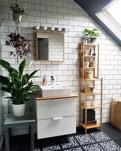 Black and white bathroom White subway tile and black floors pair perfectly in this bathroom. Finished with natural wood accents and lots of green plants, this bathroom design feels like a tranquil space. Bathroom Interior Design, Interior Design Living Room, Eclectic Bathroom, Scandinavian Bathroom, Interior Livingroom, Kitchen Interior, Interior Ideas, Floor Design, House Design