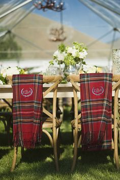 Monogrammed plaid blankets as chair back décor.  Elizabeth Anne Designs. #fallwedding #plaid #chairdecor