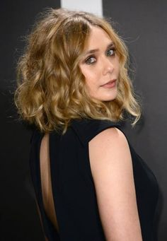 We can't get enough of this super-wavy bob on Elizabeth Olsen. Curls and lots of volume, yes please! #Celeb #Beauty