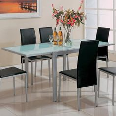 Dining Table with Frosted Glass Top Silver Metal Finish Coaster Home Furnishings http://www.amazon.com/dp/B0040Z9E3K/ref=cm_sw_r_pi_dp_4EpItb1YXBPR1KSW
