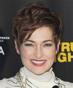 Carolyn Hennesy Hairstyle - Casual Short Straight. The back and sides of this chocolate mane is tapered into the head blending into the top layers that are jagged cut to achieve a texture and height. This fancy 'do is perfect to balance out a round face and needs regular trims to maintain style. Face Shape: Round, Oval, Heart, and Triangular.