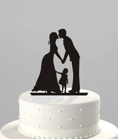 Wedding Cake Topper Silhouette Groom and Bride. The only one I've seen with a kid. Love it!!!