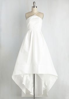 A day spent sharing hand-written promises deserves a look just as significant - specifically, this luxurious white gown. Delicate spaghetti straps support the pleated bodice and high-low skirt of this haute masterpiece, as they uphold your commitment to eternal love - and style that's truly sensational!