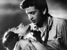 Iconic still from Barsaat (1949) with Raj Kapoor and Nargis