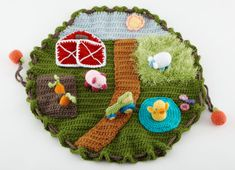 Down on the Farm Play Mat. I have made this once completely, and some elements more than once. It is easy and fun... and a real showstopper! Find it at Lion Brand Yarn. An easy crochet pattern, it took me less than a month, working after work some nights, and on weekends.