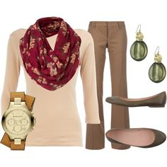 Brown pants with light pink top and red floral scarf with pink tones.