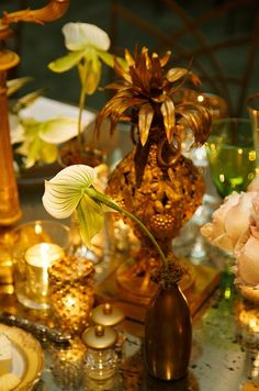 Ideas my inner wedding coordinator likes - Bouquets and Centerpieces / Exotic lady slipper orchids with moss tucked into each vase complement the metallic, ethnic décor.