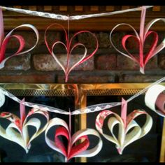 Handmade paper heart strung on a piece of lace and used as decoration for a bridal shower- PRECIOUS:) From the creative hands of Becca!