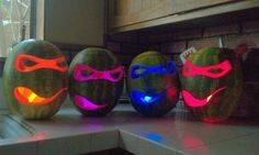 superhero pumpkins with colored glowsticks inside...would also look neat on paper bags or boxes with colored tissue paper behind the cut-outs