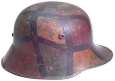 M1916 German Camo Helmet German Camo HelmetGerman Camo Helmet Fantastic example of a camo helmet: painted green, ochre yellow, and rust brown with colors separated by black stripes, six finger leather liner in great condition with no tears or other obvious damage, with cloth pockets for padding and six cloth tie strings; painted owner name: F. Lang 12. Kp.; light to moderate wear. Price ... $1350 SOLD