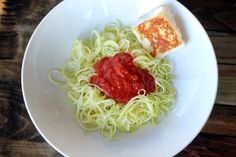 """Zucchini """"pasta"""" with peseta and houlimi"""